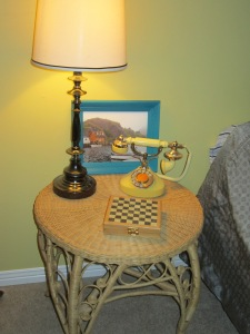 Used wicker table, princess phone and game-board. Home-made NFLD gift. Only store bought item is the lamp.